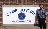 Standing in front of Camp Justice.