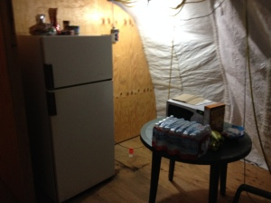 A refrigerator and microwave. Not too bad for living in a tent.