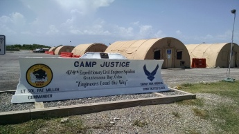 Jeff Papa - Camp Justice Sign - long one -- GTMO -- 14 September 2014