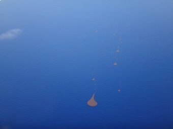 Odd droplet shaped formations dot the ocean near the Cuban island.