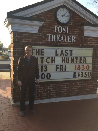 Luke in front of post theater