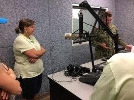 Paul Logan - Radio Gitmo - with microphone